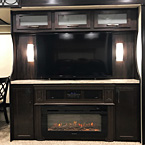 "Your residential entertainment center features several upgrades from the 50"" LED TV, Solid Surface Countertop, Furrion Stereo, New Electric Fireplace, New Sconce Lights, and ""Shaker Style"" cabinet doors."